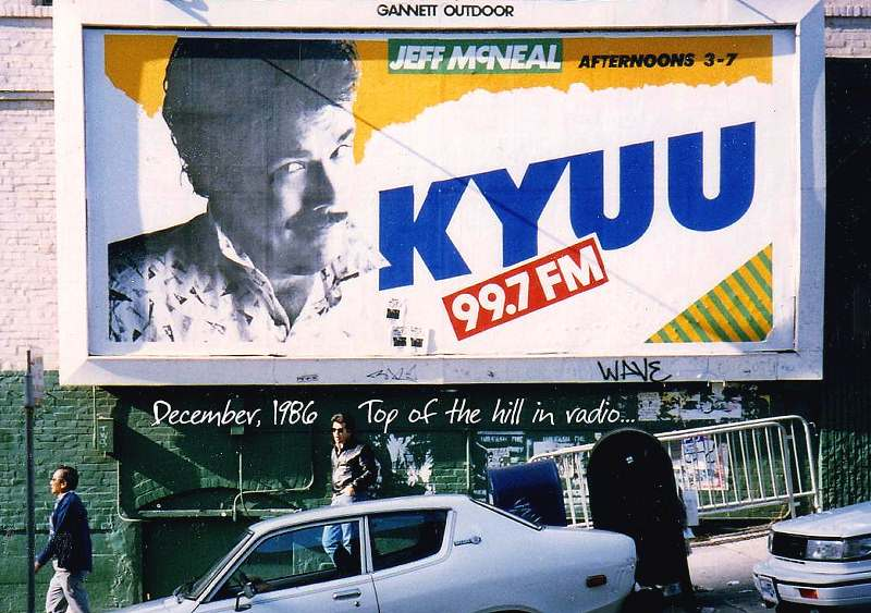 Jeff McNeal stands before his own billboard, San Francisco, December, 1986
